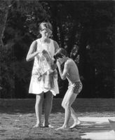 Claudia Cardinale with a small child.