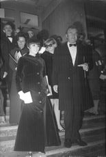 Mireille Mathieu standing on the steps with Johnny Stark.