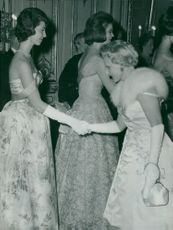 Princess Désirée is greeted by Ingrid Gärde Widemar at the Palace of the Castle. In the background the princesses Birgitta and Margaretha