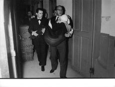 Ludmilla Tcherina being carried by men.