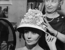 Ludmilla Tcherina trying on a hat.