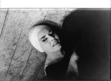 Ludmilla Tcherina, in agony, after falling down on floor.