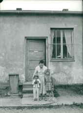 Germany: Dachau: Mother and two of her children.