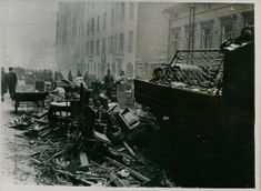 The street full of furniture that had survived the destruction, but have not yet had time carted away.