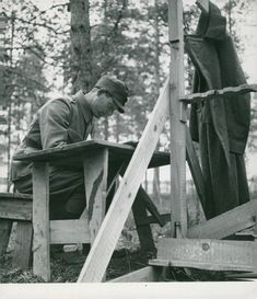 A soldier reading during the Russo-Finnish war, 1941.
