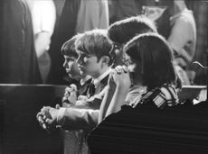 """Children crying for Robert Francis """"Bobby"""" Kennedy."""