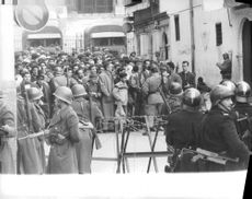 People crowding with surrounding soldiers and police during the Algerian War, 1960.