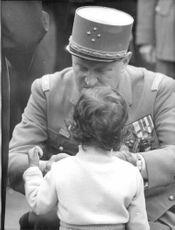 Soldier giving something to the child during Algerian War, 1960.