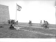 Soldiers raised the flag of Israel.