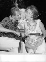 King Juan Carlos I and his wife Sofia playing with their children.