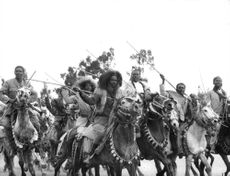 Warriors on horses; Elizabeth II state visit to Ethiopia.