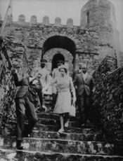 Elizabeth II reaching out to prince Philip who is almost slipping in stairs, Ethiopia.