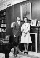 Queen Sophia and Juan Carlos with their pet dog.