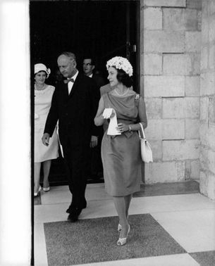 Princess Margaret taking her glove off, with a man.