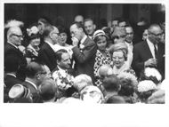 Princess Juliana with consort Prince Bernhard in a crowd.