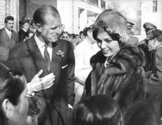 Prince Philip talking to Farah Pahlavi in an event.  - Mar 1961