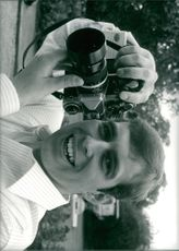Prince Andrew taking photographs.