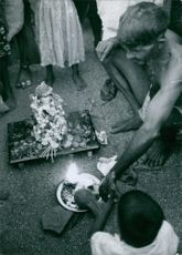Indian people doing ritual activity.
