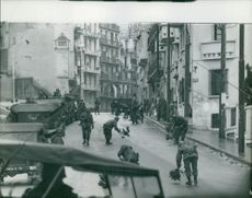 Soldiers cleaning the road in Algeria.  Taken - Mar. 1962