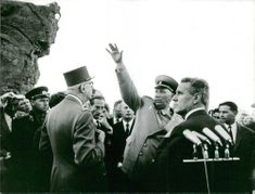 Charles de Gaulle standing in front of the crowd, 1966.