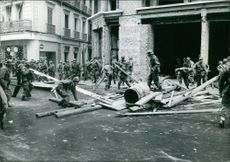 Soldiers working on a place of destruction.