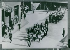 People turning their backs on German army band marching through Oslo, Norway.