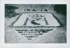 """Sign on ground  """"Long live H7, he will come back"""" for Haakon VII, Norway. 1940."""