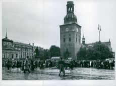 The picture was taken on the main square in Oslo and shows the crowd standing and waiting to get a place in Ekeberg cart.