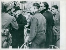 German soldier having a conversation with Norwegian civilians. Norway.