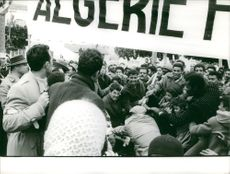 Soldier trying to confiscate banners from the demonstrators which caused a commotion between the two groups in Algeria.