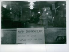 Sign offering vegetable soup in shop window, no meat available, Norway 1943.