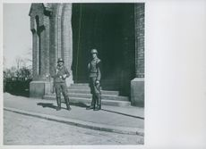 Two German soldiers standing in front of church in Oslo, Norway 1943.