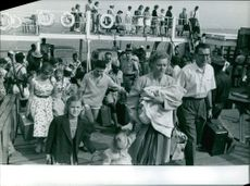 A ferryboat unloading its passengers on the port area.