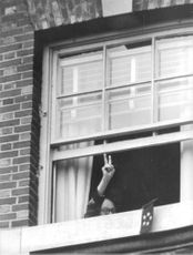 "Dwight David ""Ike"" Eisenhower. showing him self at the window."