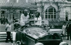 Three people on board the Rolls Royce.
