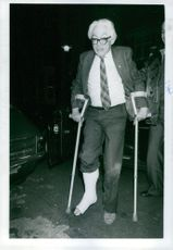 Michael Mackintosh Foot with a casted right foot and walking with the help of crutches.
