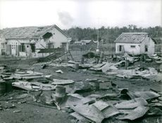 Houses damaged by bombings and explosions. Vietnam.