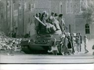 Men sitting and standing on the tank. November 5, 1962.