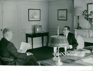 Pierre Mendes France and Gaston Paul Charles Defferre having a conversation.