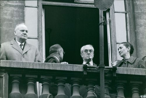 Men and woman standing at balcony. 1963