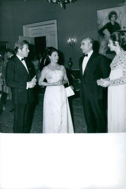 Princess Margaret and Antony Armstrong-Jones talking to another couple.