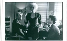 """Tom Cruise as Mitch McDeere, Gary Busey as Eddie Lomax and Holly Hunter as Tamara """"Tammy"""" Hemphill in a scene from the movie """"The Firm"""", 1993."""