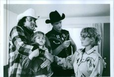 """A scene from the film """"Blind Fury"""", with Rick Overton as Tector Pike, Nick Cassavetes as Lyle Pike, Brandon Call as Billy Deveraux and Brandon Call as Billy Deveraux, 1990."""