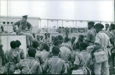 A vintage photo of a military official addressing his troops of what to do during a Crisis in Congo, 1960
