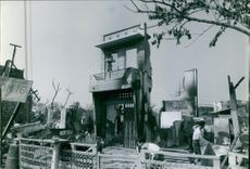 Vietnamese men cleaning up the wreckage of the ruined buildings in Cholon, Vietnam.