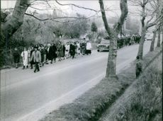 Vintage photo of people attending funeral of Gaston Dominici. Photo taken in April 1965.