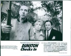 Faye Dunaway, Jason Alexander and Paul Reubens in a scene from the movie Dunston Checks In.