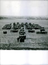 Soldiers gathered together in columns of  tanks and miltary vehicles during wartime in France. 1963