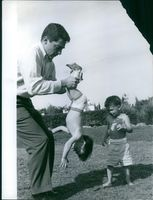Mike Todd playing with his two sons in Malaqa. Photo taken on April 13, 1959.