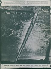 An aerial view of a burnt bridge over sea during Tyskland war.